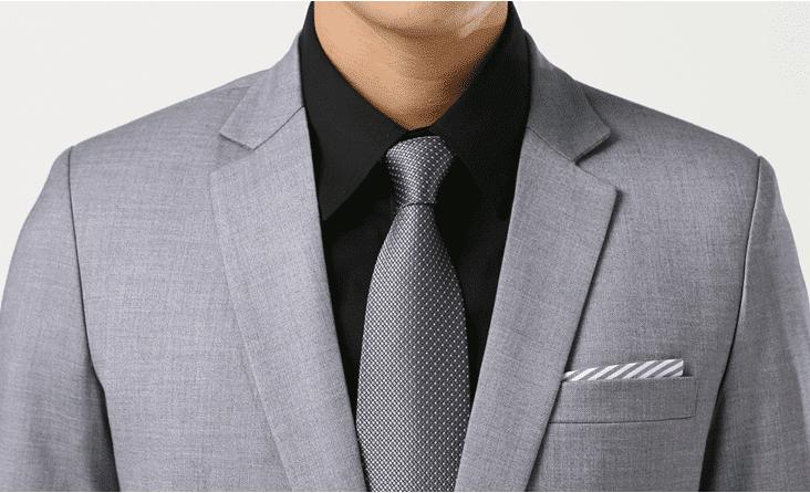 camisa negra con traje gris
