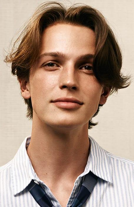 Cara redonda corte de pelo hombre